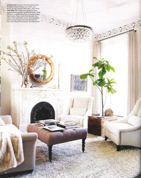 grey sofa white chairs white shag rug gold accents