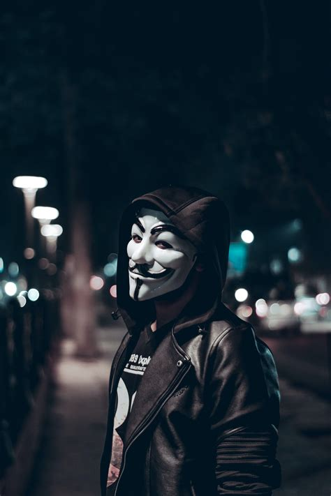 person wearing guy fawkes mask  stock photo