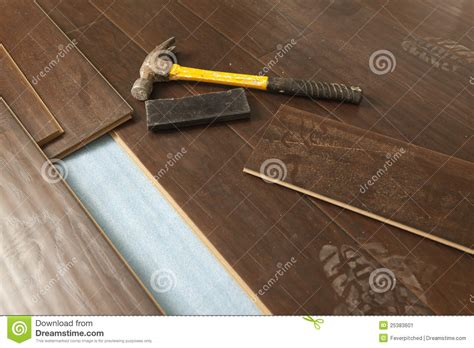 flooring hammer hammer and block with new laminate flooring stock image image 25383601