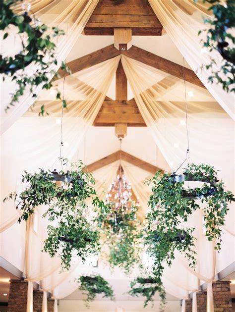 bohemian texas wedding with fall foliage wedding reception ideas wedding ceiling decorations