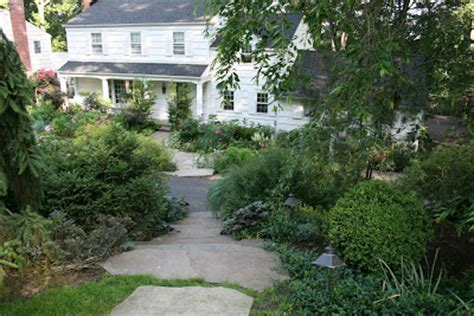 landscaping ideas for a sloped front yard landscape design ideas for sloped front yard