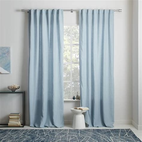 light blue walls gold curtains