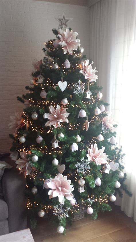 elegant christmas tree decorated  big pink flowers