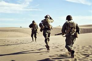 Three Wwii Soldiers Running In The Desert Sand Photograph ...