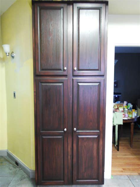 Free Standing Corner Pantry Cabinet On Brown Laminate Wood