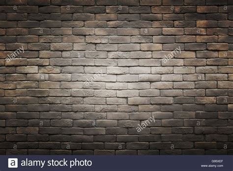 black brown gray brick wall background with light