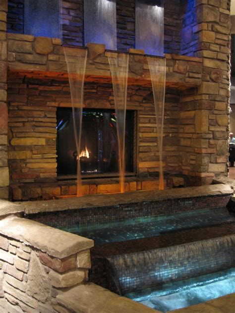 outdoor fireplace  water feature indoor waterfall water walls stone wall design