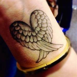 Realistic wing's heart tattoo - TattooMagz
