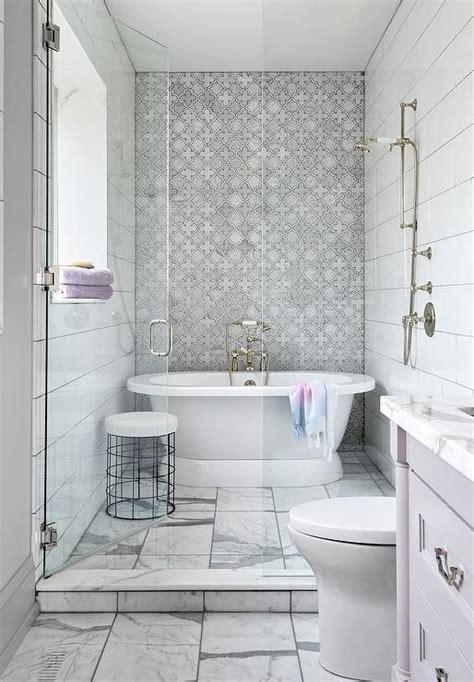 small walk  shower featuring  freestanding roll top