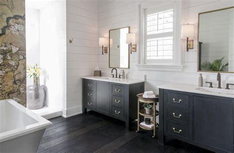 black bathroom vanity  gold mirrors transitional