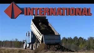 CAT 416 Loading the International Dump Truck with Gravel ...