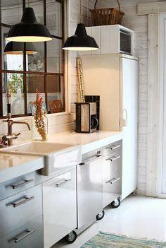 mirror above kitchen sink 1000 images about mirrored backsplash on 7528