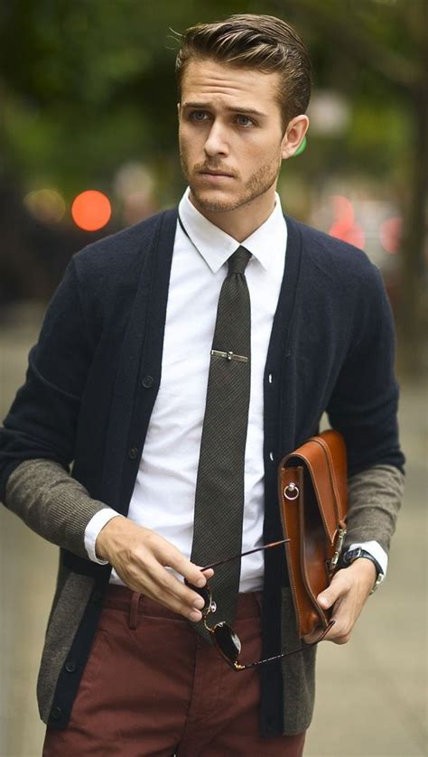 A basic scene. Male model + cardigan tie tie clip portfolio in arms. Hair gelled up ...