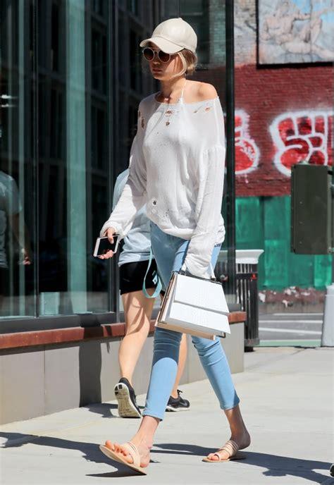 gigi hadid wearing blue jeans july  popsugar fashion