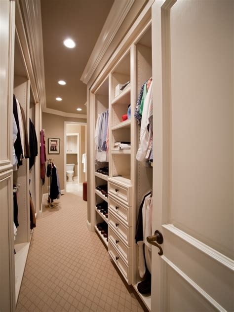 walk in closet that leads to bathroom house