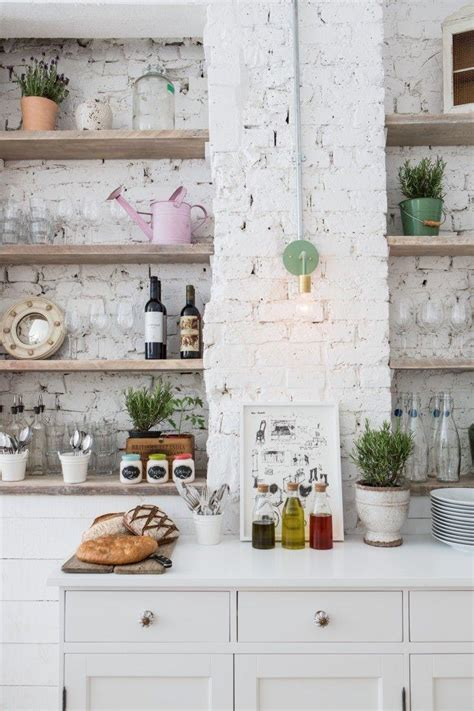 white kitchen walls create a chic statement with a white brick wall 484 | Rustic eclectic kitchen with a white brick wall