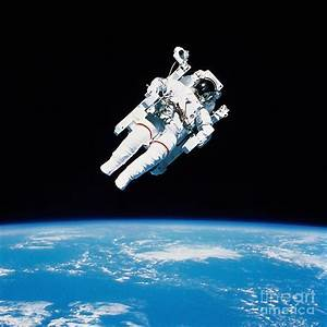 Astronaut Floating In Space Photograph by Stocktrek Images