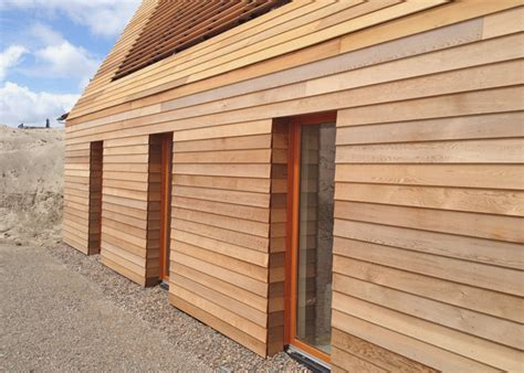 North Sea Wood House: Framed in Siberian Larch and Clad in