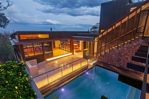 2 story house with pool gorgeous use of wood takes this mansion to the next level