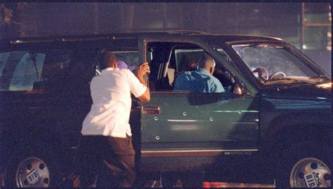 Picture Of Biggie's Suv After It Was Shot Up, But While He