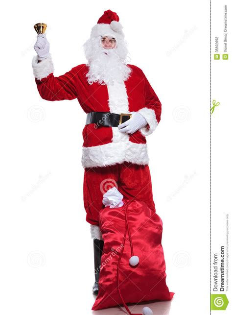 traditional santa claus ringing on full length santa claus holding a bell royalty free stock image cartoondealer com 60704212