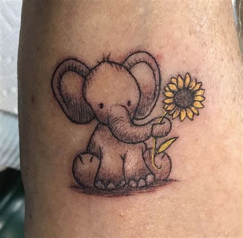 sunflowers elephants alzheimers tattoo tattoo ideas