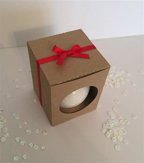 christmas ornament bauble gift box in kraft card with viewing