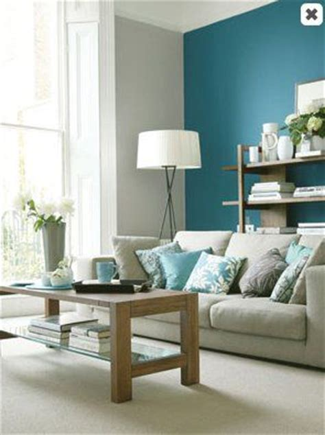 teal accent wall in a light gray living room blue paint