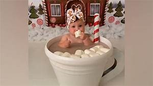 This baby in a cup of hot cocoa is keeping things sweet on Christmas