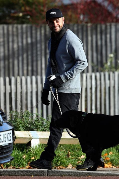 A cheery Ant McPartlin is all smiles on solo dog walk as ...