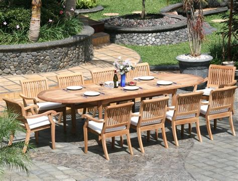 Teak Outdoor Dining Table And Wicker Chairs — Home Ideas
