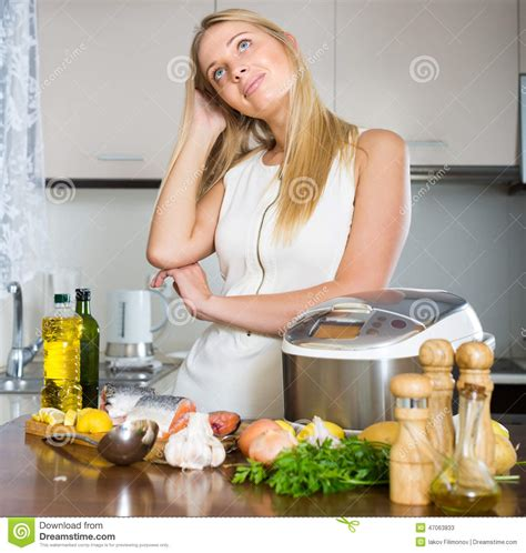 dishes to cook housewife thinking what to cook for dinner stock photo image 47063833