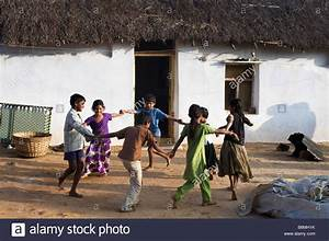 Indian children playing games outside a rural village home ...