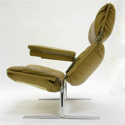 comfortable steel and leather lounge chair and ottoman by