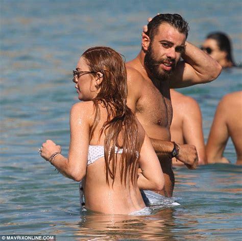 actress from long beach lindsay lohan continues bikini parade as she hits the