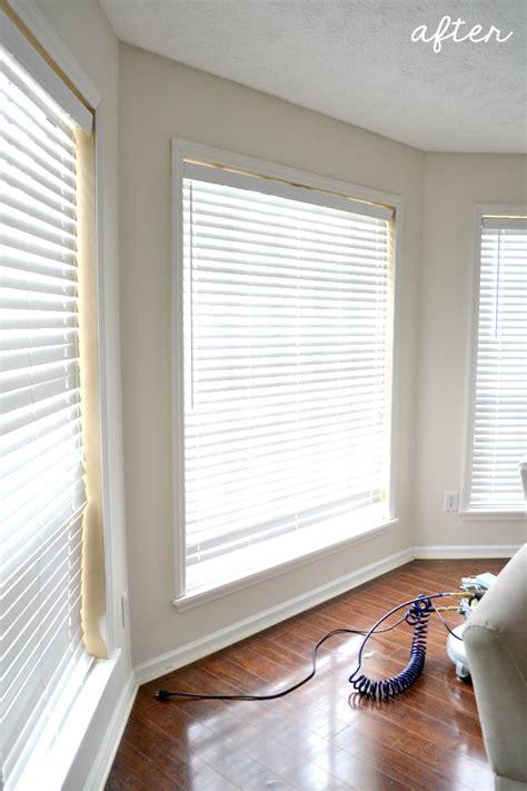 adding trim   living room windows  ugly duckling