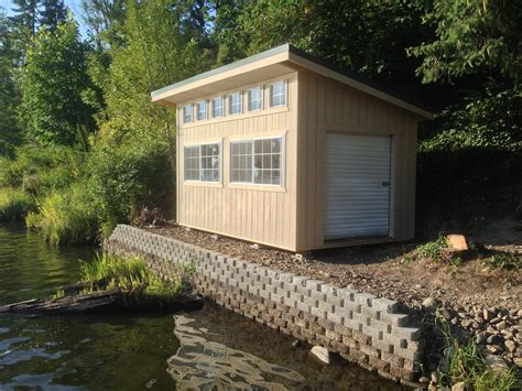 shed up slant roof style with dormer and roll up door water front