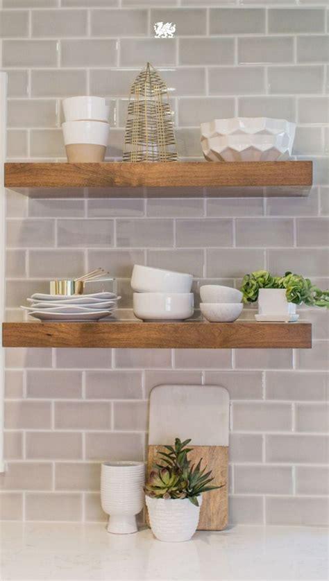 Modern Kitchen Tile Backsplash Ideas by Floating Wood Shelves Against A Subway Tile