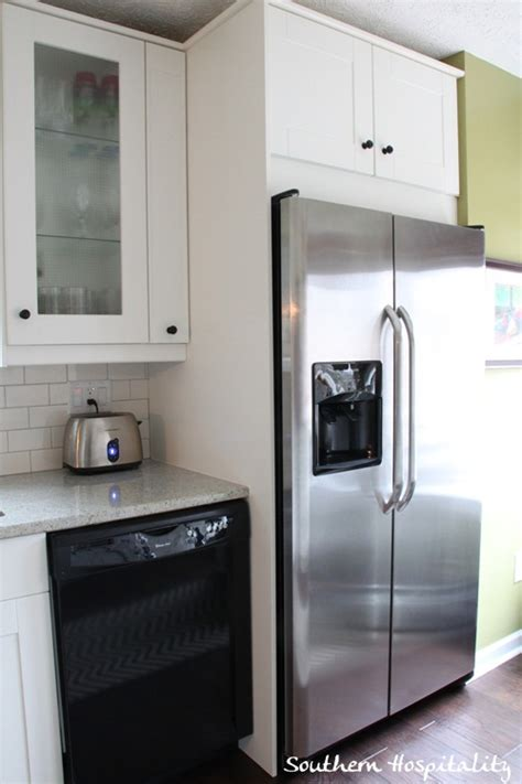 cabinets around fridge built in fridge