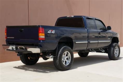 purchase   chevy silverado ls  ext cab  owner autocheck cert lifted  chrome whls