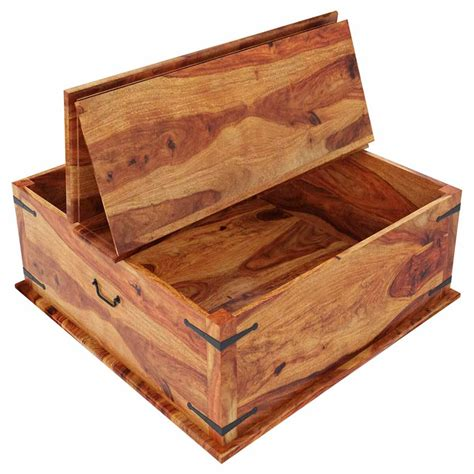 The trunk is made of solid sheesham wood and features metal hardware. Large Square Storage Box Trunk with Metal Accents Coffee Table
