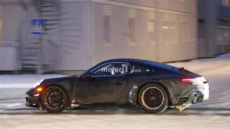 2020 porsche mission e electric sedan spied testing alongside teslas the 2019 porsche 911 prototype play in the snow