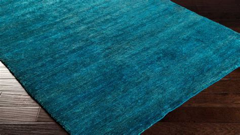 area rug teal knotted crusoe area rug teal zuri furniture 1334