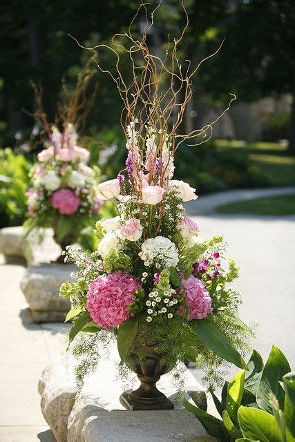 outside flower arrangements my flower arrangement ideas love this vintage top hats using old letters and sheet music