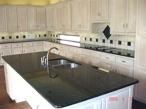 kitchen island with white granite countertop and sink also
