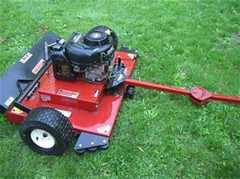 tow  mowers swisher  pull  mower