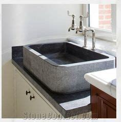 kitchen sink materials pros and cons uk contemporary kitchen island belgian blue worktop