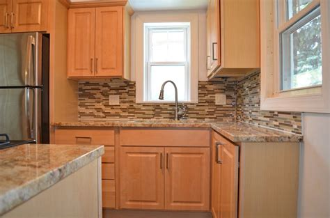 granite countertops and cabinets kitchen remodel with natural maple cabinets granite