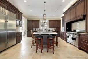 luxury kitchen floor plans a large luxury kitchen design with walnut stained cabinets