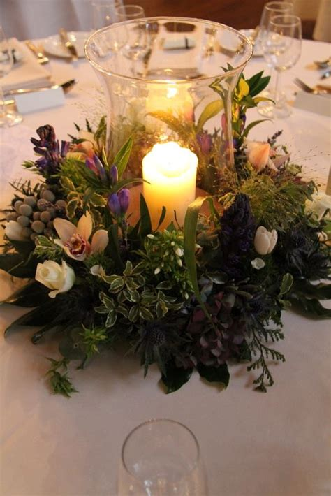 Hurricane Vase Centerpieces For Weddings by A Traditionally Beautiful Hurricane Vase And Floral Wreath